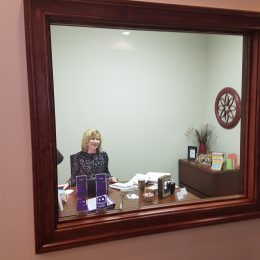 satisfied client with a new office mirror
