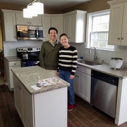 happy customers in their finished kitchen