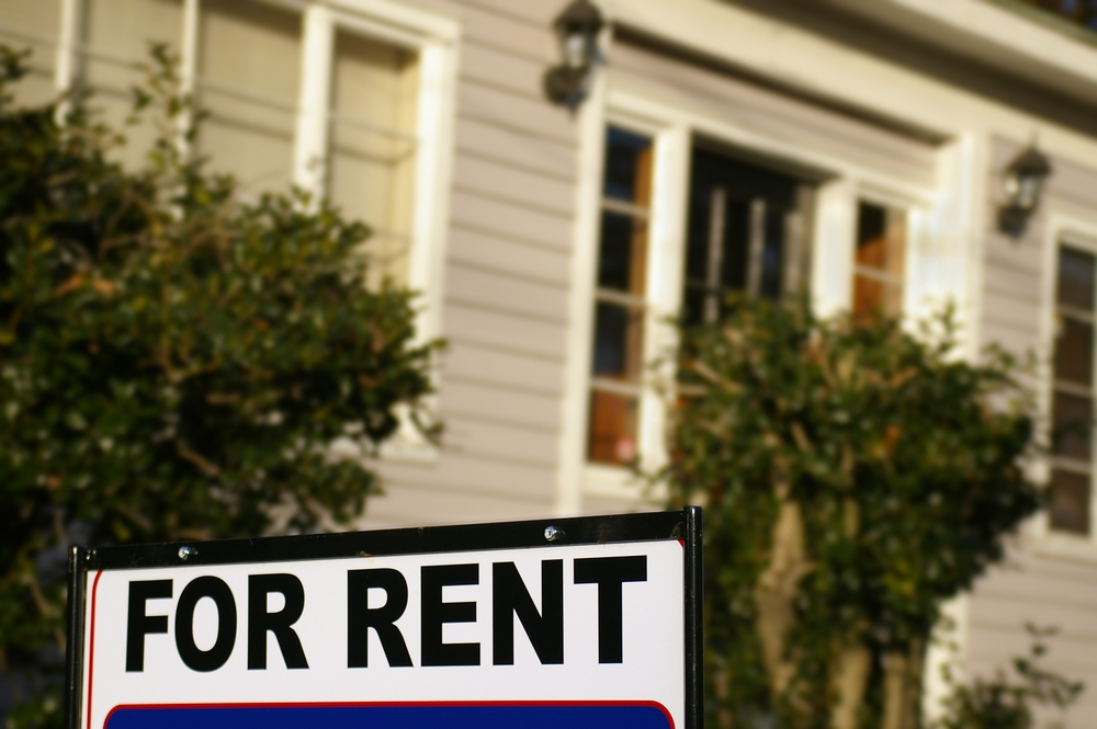 """House with """"For Rent"""" sign"""