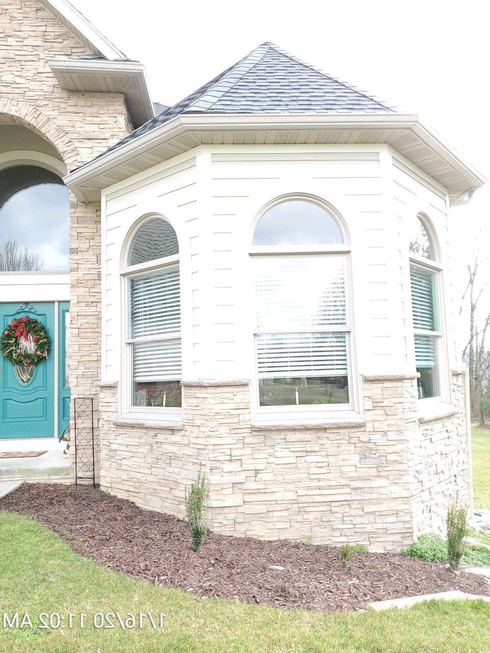 exterior siding on stone house